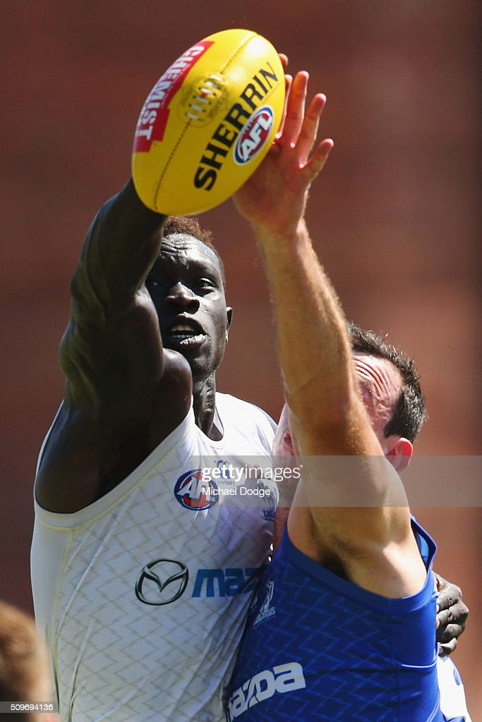<a gi-track='captionPersonalityLinkClicked' href=/galleries/search?phrase=Majak+Daw&family=editorial&specificpeople=6756476 ng-click='$event.stopPropagation()'>Majak Daw</a> of the Kangaroos (L) and Todd Goldstein of the Kangaroos compete for the ball during the North Melbourne AFL Intra-Club match at Arden Street Ground on February 12, 2016 in Melbourne, Australia.