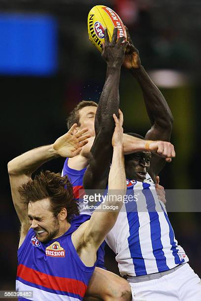 Majak Daw of the Kangaroos compete for the ball against Joel Hamling of the Bulldogs during the round 20 AFL match between the Western Bulldogs and...