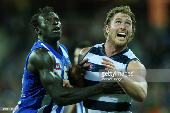 Majak Daw of the Kangaroos competes for the ball Dawson Simpson of the Cats during the round 10 AFL match between the Geelong Cats and the North...