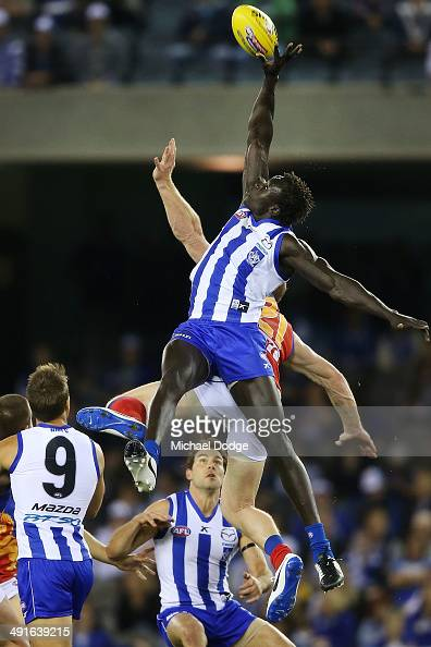 Majak Daw of the Kangaroos contests for the ball against Daniel Merrett of the Lions during the round nine AFL match between the North Melbourne...