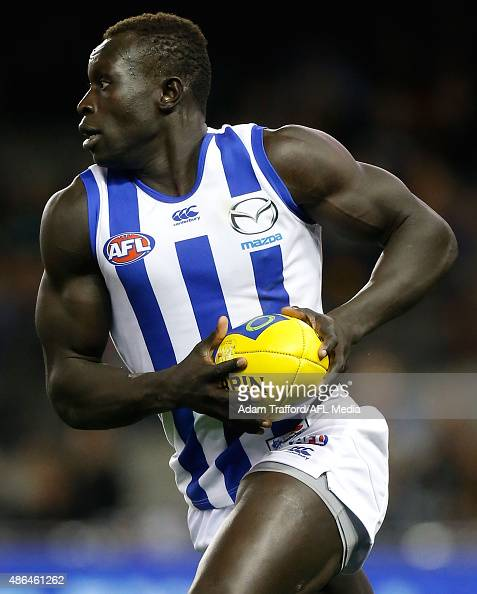 Majak Daw of the Kangaroos in action during the 2015 AFL round 23 match between the Richmond Tigers and the North Melbourne Kangaroos at Etihad...