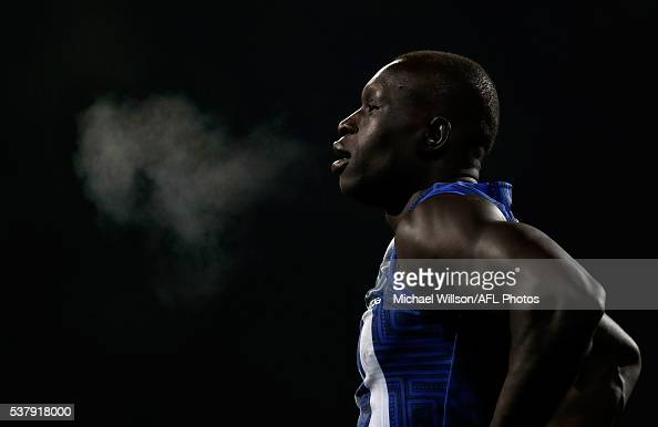 Majak Daw of the Kangaroos looks on during the 2016 AFL Round 11 match between the North Melbourne Kangaroos and the Richmond Tigers at Blundstone...