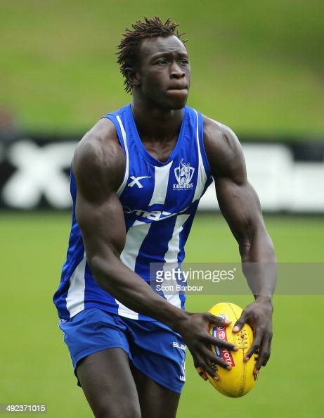 Majak Daw of the Kangaroos looks to kick the ball during a North Melbourne Kangaroos AFL media training session at Arden Street Ground on May 20 2014...
