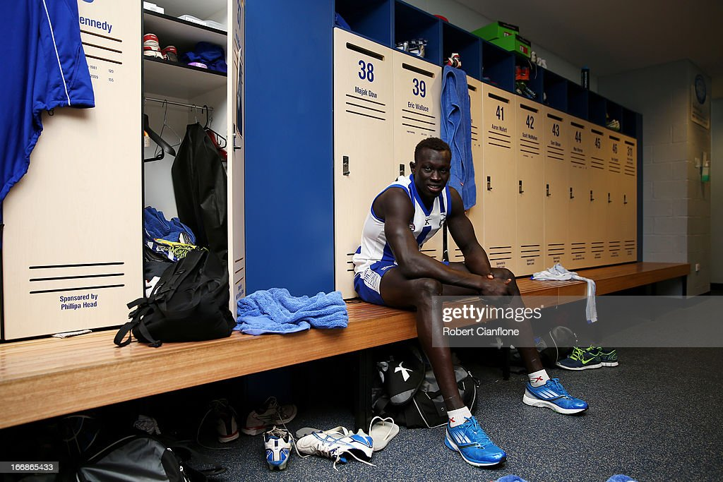 Majak Daw of the Kangaroos poses after it was announced he would make his AFL debut during a North Melbourne Kangaroos AFL media session at Aegis Park on April 18, 2013 in Melbourne, Australia.