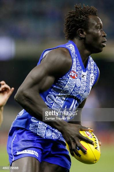 Majak Daw of the Kangaroos runs with the ball during the round 12 AFL match between the North Melbourne Kangaroos and the Richmond Tigers at Etihad...