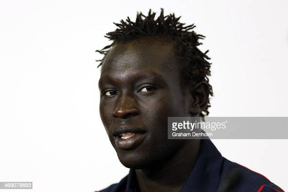 Majak Daw of the North Melbourne Kangaroos talks to the media during the launch of the AFL Multicultural Ambassador Program at AFL House on February...