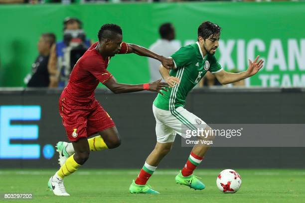 Majeed Abdul Waris of Ghana fights for the ball with Rodolfo Pizarro of Mexico during the friendly match between Mexico and Ghana at NRG Stadium on...