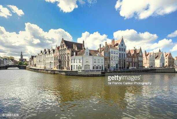 Majestic image of Bruges Spiegelrei canal waterfront with romantic sky in Flanders, Belgium