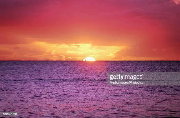 Majestic multi-colored sunset over purple sea