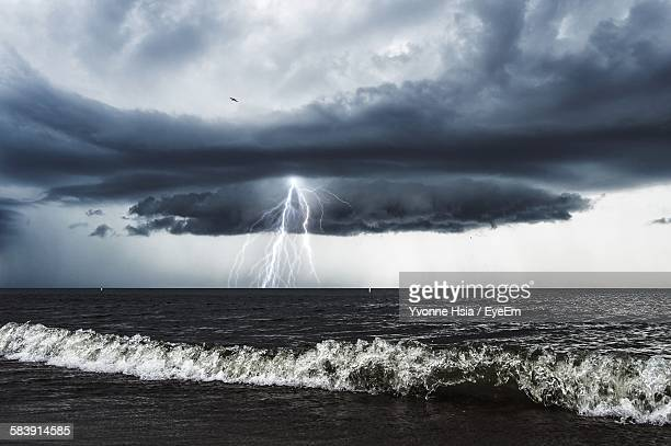 Majestic View Of Thunderstorm Lightning Over Sea Against Sky