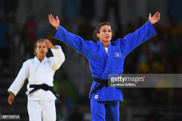 Majlinda Kelmendi of Kosovo celebrates winning the gold medal as Odette Giuffrida of Italy looks dejected during the Women's 52kg gold medal final on...