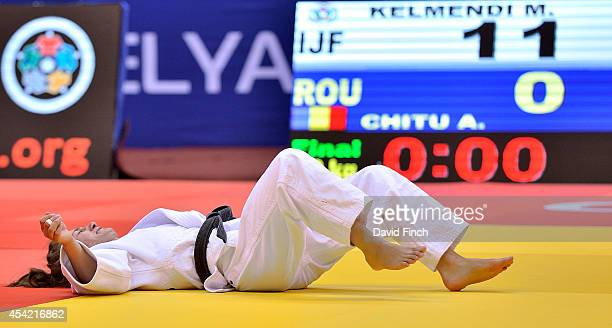Majlinda Kelmendi of Kosovo collapses with emotion after defeating Andreea Chitu of Romania to win her second u52kg World gold medal during the...