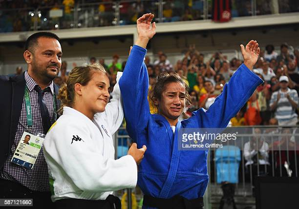 Majlinda Kelmendi of Kosovo is congratulated as she wins gold by silver medalist Odette Giuffrida of Italy afterthe Women's 52kg gold medal final on...