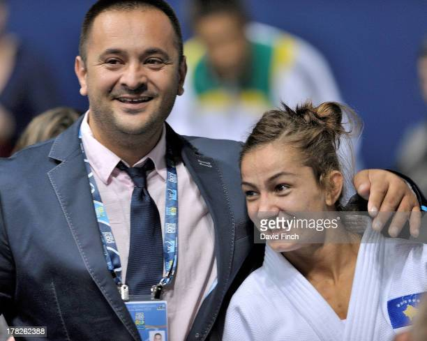 Majlinda Kelmendi of Kosovo is congratulated by her coach Dritton Kuka after winning the u52kgs final during day 2 of the Rio World Judo...