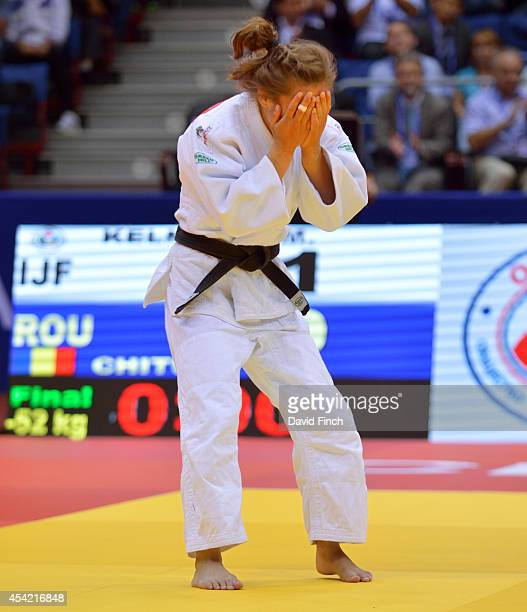 Majlinda Kelmendi of Kosovo weeps with emotion after defeating Andreea Chitu of Romania to win her second u52kg World gold medal during the...