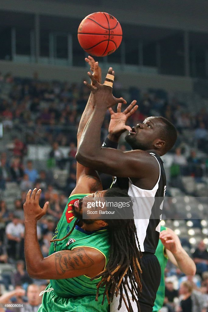 Majok Majok of Melbourne United and Jordair Jett of the Townsville Crocodiles compete for the ball during the round seven NBL match between Melbourne...