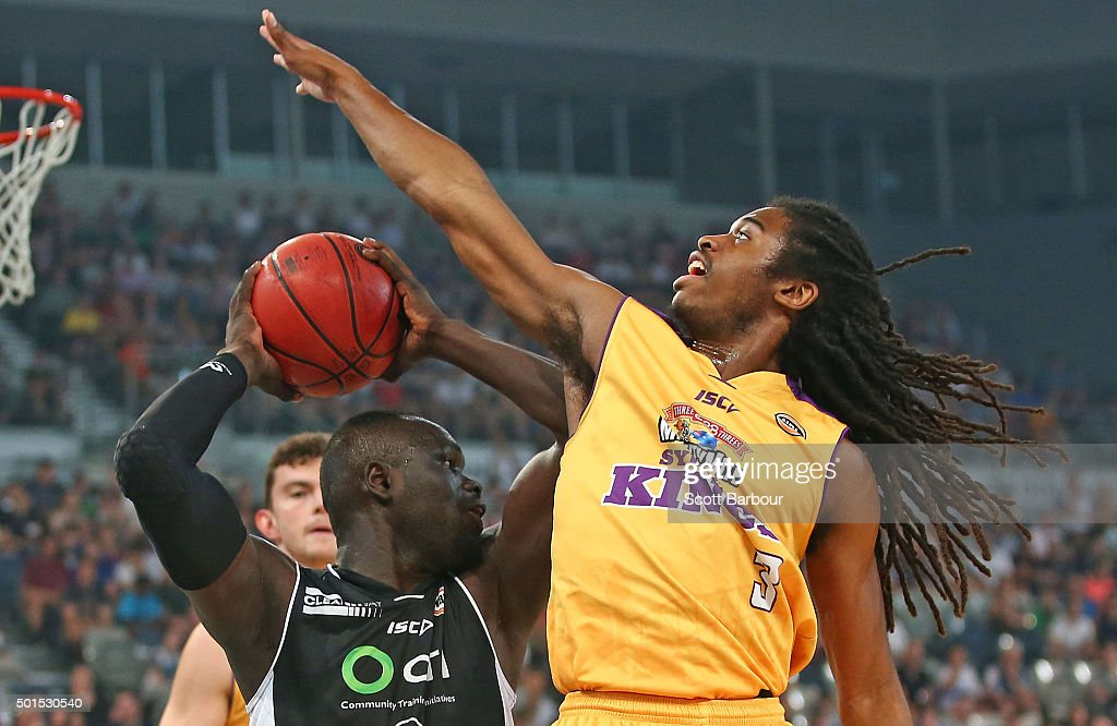 Majok Majok of Melbourne United and Marcus Thornton of the Sydney Kings compete for the ball during the round 11 NBL match between Melbourne United...