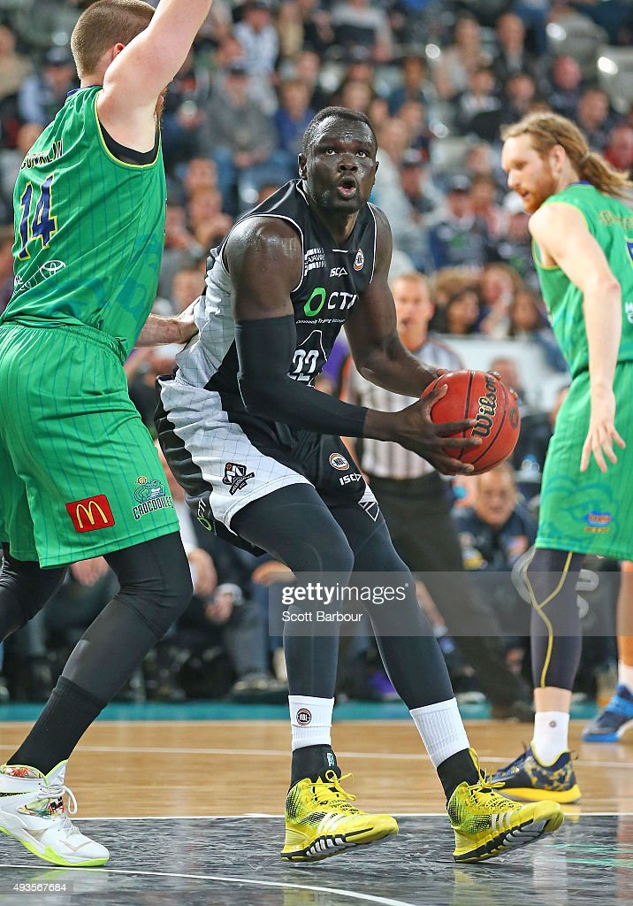 Majok Majok of Melbourne United drives to the basket as Luke Schenscher of the Townsville Crocodiles defends during the round three NBL match between...