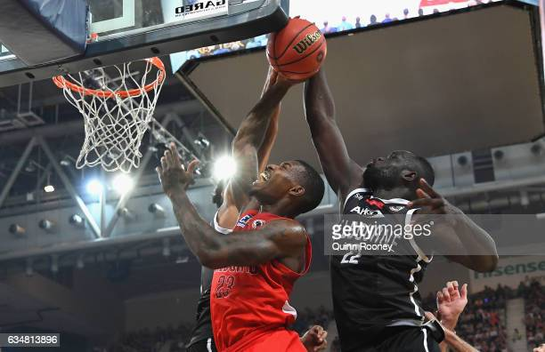 Majok Majok of United blocks a shot by Casey Prather of the Wildcatsduring the round 19 NBL match between Melbourne United and the Perth Wildcats at...