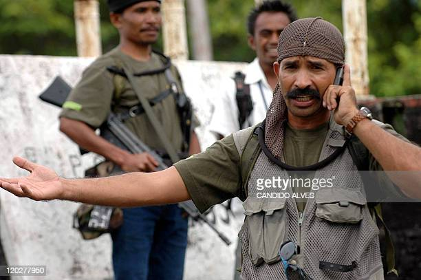 Major Alfredo Reinado Alves gestures as he talks on a mobile phone at his headquarter in Same around 120 kilometres south of Dili 27 February 2007...