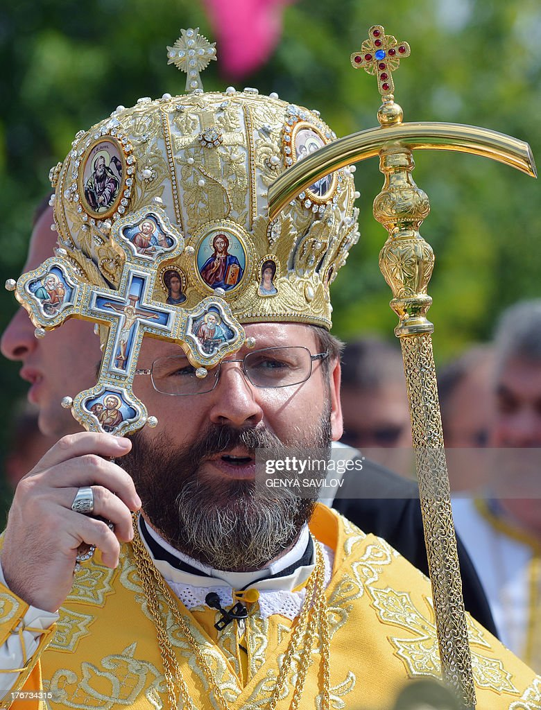 Major Archbishop Sviatoslav Shevchuk, head of the Ukrainian Greek-Catholic Church blesses believers in Kiev on August 18, 2013 during the Rite of the Blessing of the Patriarchal Cathedral of the Ukrainian Greek-Catholic Church.