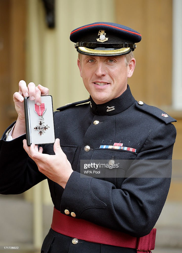 Major Edward Colver from OC Corunna Company, 3rd Bn The Yorkshire Regiment, holds his MBE medal after he received the award from Prince Charles, Prince of Wales during an Investiture ceremony at Buckingham Palace on June 28, 2013 in London, England. Mo Farah will receive an CBE for services to Athletics.
