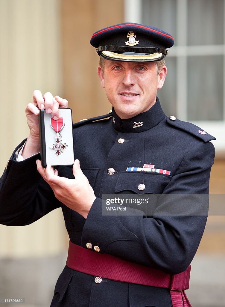 Major Edward Colver from OC Corunna Company, 3rd Bn The Yorkshire Regiment, holds his MBE medal for services in Afghanistan after he received the award from Prince Charles, Prince of Wales during an Investiture ceremony at Buckingham Palace on June 28, 2013 in London, England. Mo Farah will receive an CBE for services to Athletics.