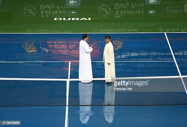 Major Essa Al AhliDubai Police and Salah Tahlak Tournament Director inspects the court during a rain delay on day three of the WTA Dubai Duty Free...