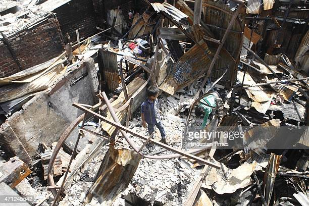 A major fire broke out at Shastri Nagar slums destroying a lot of shanties close to Bandra station on April 26 2015 in Mumbai India According to the...