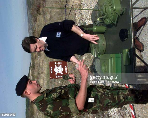 Major Gareth Baker from the British Forces in Bosnia shows Defence Secretary George Robertson the rudimentary workings of mines after a visit to a...