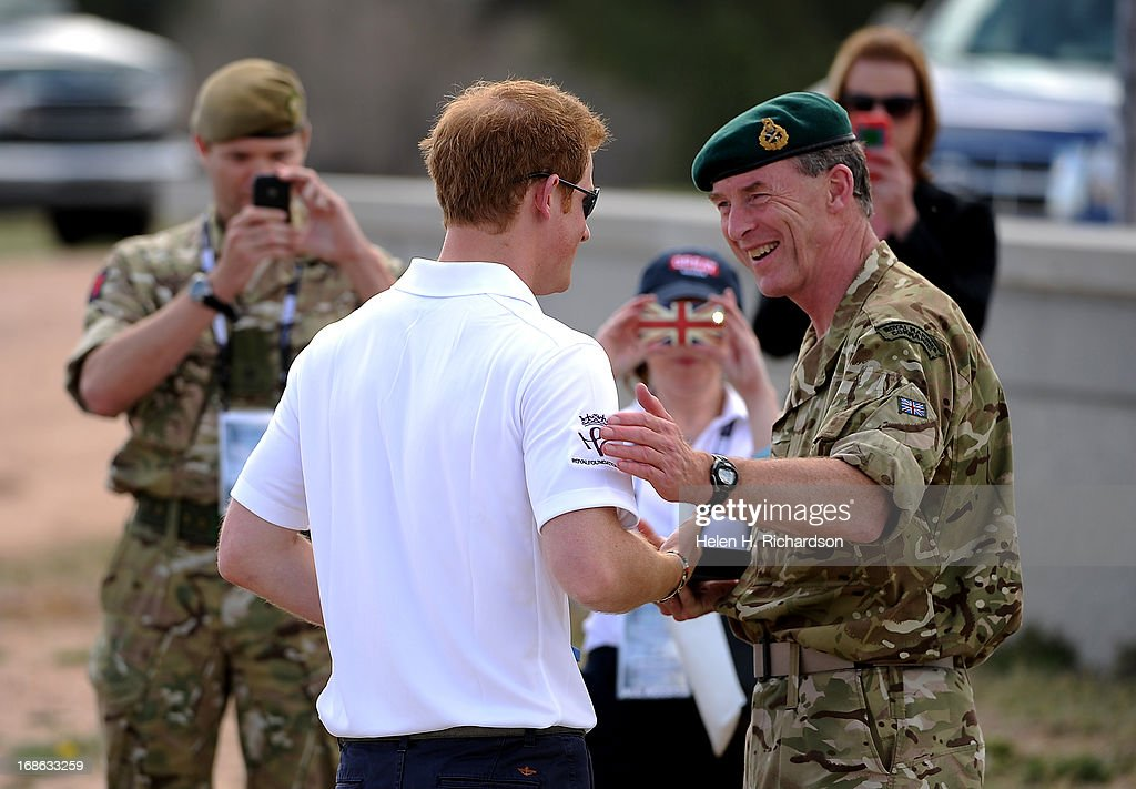 Major General Buster Howes, OBE, Defense Attache & Head of British Defence, right, and Prince Harry shake hands and have a laugh after the awards ceremony. The fourth annual Warrior Games cycling event took started and finished at Falcon Stadium on the grounds of the Air Force Academy in Colorado Springs, CO on May 12, 2013. HRH Prince Harry was on hand to start the race as well as to hand out medals at the finish line. A total of 260 wounded, ill and injured service members and veterans came to compete in the week long games. Members of the Army, Marine Corps, Navy/Coast Guard/Air Force. Special Operations and the British Armed Forces all took part in the competition. Other events included in the Warrior Games are shooting, sitting volleyball, track & field and wheelchair basketball.