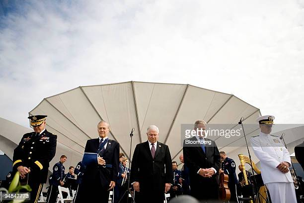 Major General Douglas Carver US Army Chief of Chaplains left Donald Rumsfeld former US secretary of defense second from left Robert Gates current US...