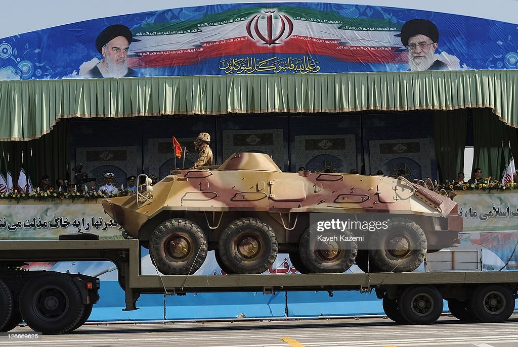 Major General Hassan Firoozabadi alongside other military commanders observes armoured vehicles during a parade commemorating the 31st anniversary of Iran-Iraq war on September 22, 2011 in Tehran, Iran. Iran is holding military parades in Tehran and other parts of the country on the first day of the Sacred Defence Week. Tehran's parade began to the north of Imam Khomeini's mausoleum providing the army, Islamic Revolution Guards Corps, Law Enforcement Force and Basij with an opportunity to display their state of military preparedness, in which armaments and indigenously built military equipment including Shahab missiles, unmanned aircrafts, Zulfaqar tanks, and a variety of rapid fire machine guns were showcased.