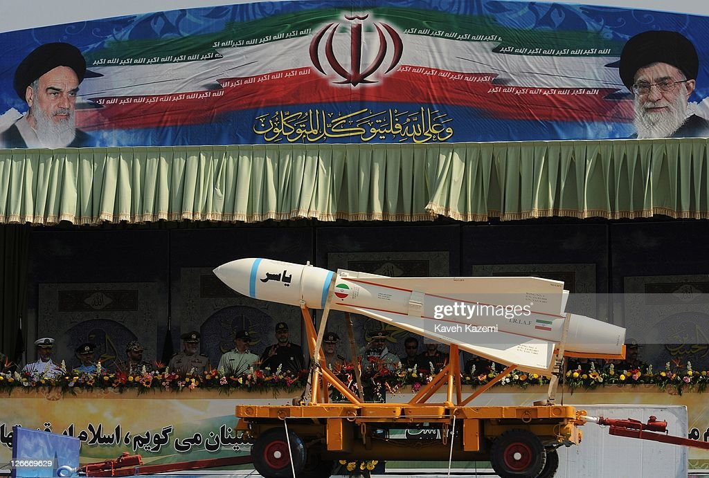Major General Hassan Firoozabadi alongside other military commanders observes ballistic missiles during a parade commemorating the 31st anniversary of Iran-Iraq war on September 22, 2011 in Tehran, Iran. Iran is holding military parades in Tehran and other parts of the country on the first day of the Sacred Defence Week. Tehran's parade began to the north of Imam Khomeini's mausoleum providing the army, Islamic Revolution Guards Corps, Law Enforcement Force and Basij with an opportunity to display their state of military preparedness, in which armaments and indigenously built military equipment including Shahab missiles, unmanned aircrafts, Zulfaqar tanks, and a variety of rapid fire machine guns were showcased.