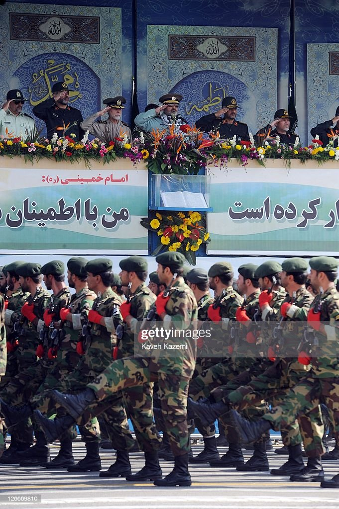 Major General Hassan Firoozabadi (C) salutes alongside other military commanders as they observe a parade commemorating the 31st anniversary of Iran-Iraq war on September 22, 2011 in Tehran, Iran. Iran is holding military parades in Tehran and other parts of the country on the first day of the Sacred Defence Week. Tehran's parade began to the north of Imam Khomeini's mausoleum providing the army, Islamic Revolution Guards Corps, Law Enforcement Force and Basij with an opportunity to display their state of military preparedness, in which armaments and indigenously built military equipment including Shahab missiles, unmanned aircrafts, Zulfaqar tanks, and a variety of rapid fire machine guns were showcased.