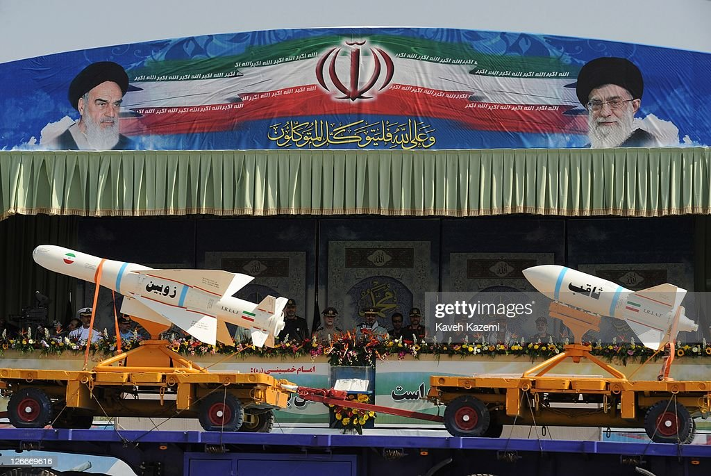 Major General Hassan Firoozabadi stands alongside other military commanders as they observe ballistic missiles during a parade commemorating the 31st anniversary of Iran-Iraq war on September 22, 2011 in Tehran, Iran. Iran is holding military parades in Tehran and other parts of the country on the first day of the Sacred Defence Week. Tehran's parade began to the north of Imam Khomeini's mausoleum providing the army, Islamic Revolution Guards Corps, Law Enforcement Force and Basij with an opportunity to display their state of military preparedness, in which armaments and indigenously built military equipment including Shahab missiles, unmanned aircrafts, Zulfaqar tanks, and a variety of rapid fire machine guns were showcased. .