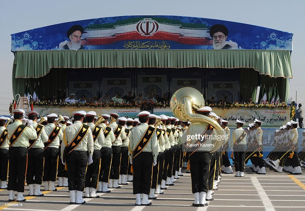Major General Hassan Firoozabadi stands alongside other military commanders as they observe a parade commemorating the 31st anniversary of Iran-Iraq war on September 22, 2011 in Tehran, Iran. Iran is holding military parades in Tehran and other parts of the country on the first day of the Sacred Defence Week. Tehran's parade began to the north of Imam Khomeini's mausoleum providing the army, Islamic Revolution Guards Corps, Law Enforcement Force and Basij with an opportunity to display their state of military preparedness, in which armaments and indigenously built military equipment including Shahab missiles, unmanned aircrafts, Zulfaqar tanks, and a variety of rapid fire machine guns were showcased.