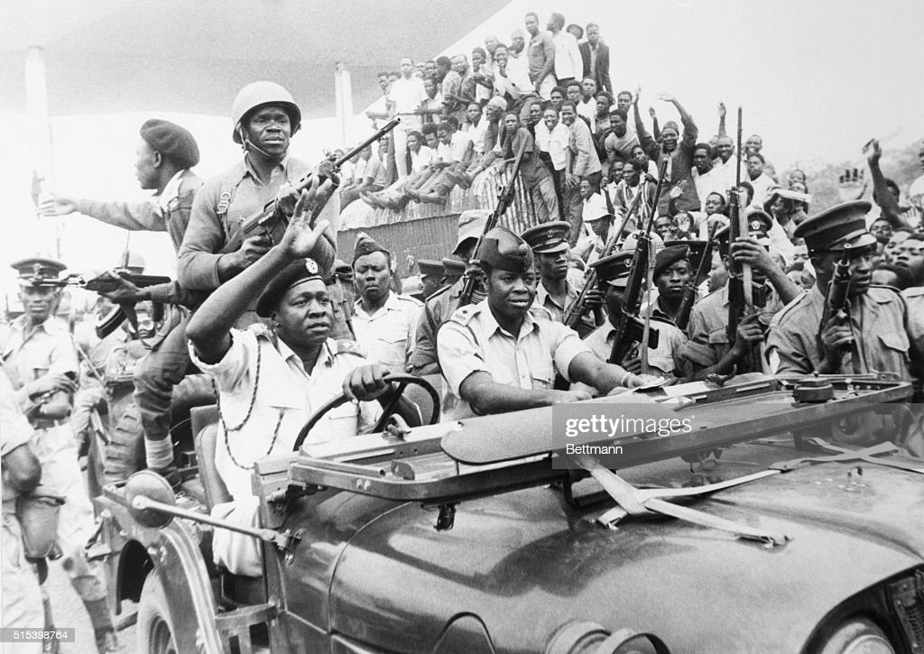 Major General Idi Amin, driving his own jeep on his way to meet recently released prisoners of the overthrown Milton Obote, waved to a crowd of 50,000 people, who are cheering Amin's overthrow of the dictator Obote. Amin was to prove a far more deadly leader.