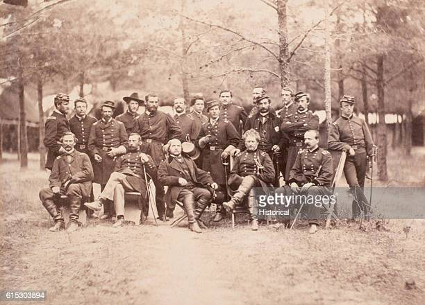 Major General Joseph Hooker commander of the Army of the Potomac poses with his staff Seated left to right are an unknown officer Major General HJ...
