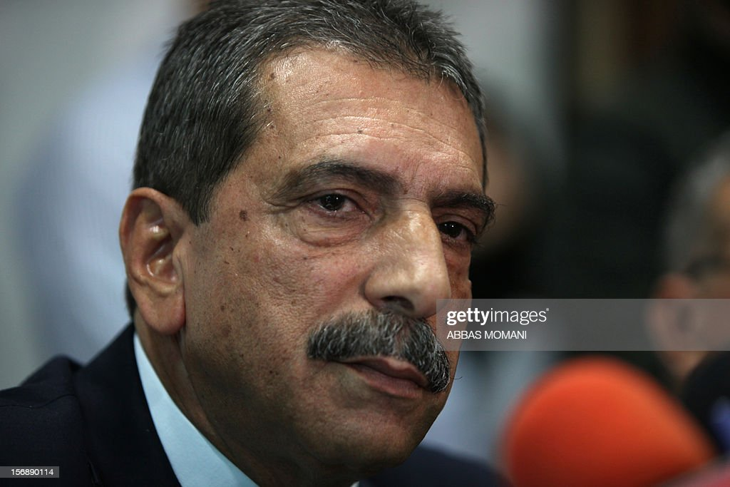 Major General Tawfiq Tirawi, the head of the Palestinian inquiry team into the death of the late Palestinian leader Yasser Arafat, looks over as he speaks to reporters during a press conference in the West Bank city of Ramallah, on November 24, 2012. The body of Arafat will be exhumed on November 27 to undergo poison tests, the head of the Palestinian inquiry team said. Rumours and speculation have surrounded Arafat's death ever since a quick deterioration of his condition saw him pass away at the Percy military hospital in suburban Paris in November 2004 at the age of 75.