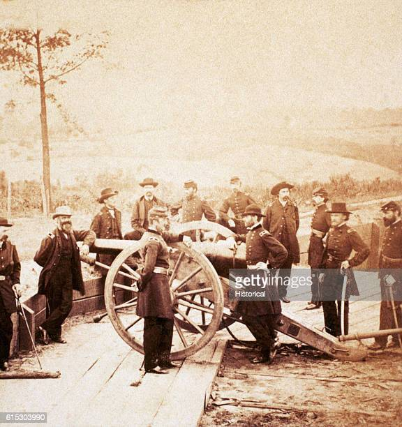 Major General William T Sherman poses at a gun emplacement with his staff ca 1864 Left to right are Major L M Dayton Lieutenant Colonel ED Kittoe...