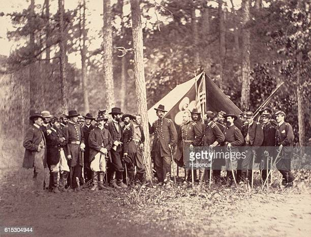 Major General Winfield Scott Hancock commander of the Second Army Corps Army of the Potomac poses with his staff in Virginia ca 1864 Brigadier...