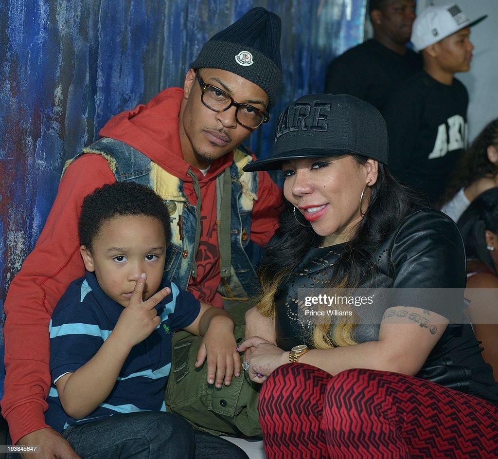 Major Harris, T.I. and Tameka 'Tiny' Harris attend Domani Harris's birthday celebration at Indigo on March 16, 2013 in Toronto, Canada.