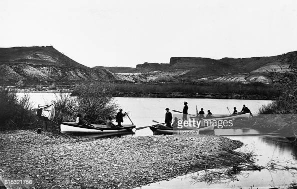 Major John Wesley Powell standing erect in his boat Emma Dean at the beginning of his 1871 survey of the Colorado and Green river basins Green River...