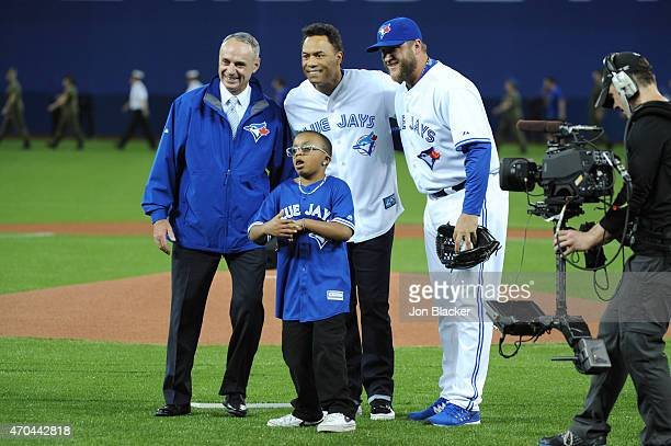 Major League Baseball Commissioner Robert D Manfred Jr and Hall of Famer Roberto Alomar and Mark Buehrle pose for a photo with Ben Sheppard after the...
