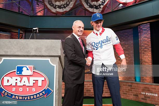 Major League Baseball Commissioner Robert D Manfred Jr shakes hands with Cathedral High School pitcher Ashe Russell after being selected 21st overall...
