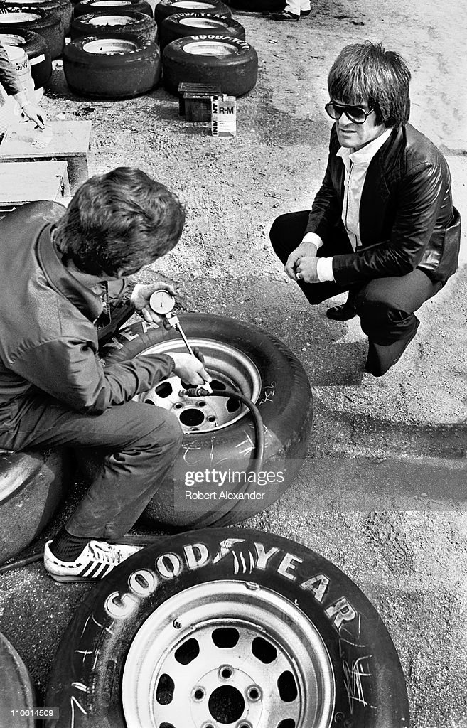 Major League Baseball great Pete Rose talks with a NASCAR crew member at the Daytona International Speedway during preparations for the 1981 Daytona 500 in Daytona Beach, Florida.