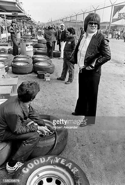 Major League Baseball great Pete Rose talks with a NASCAR crew member at the Daytona International Speedway prior to the start of the 1981 Daytona...