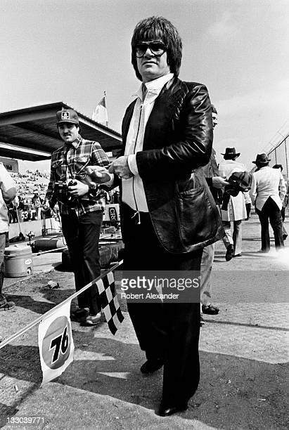 Major League Baseball great Pete Rose visits the pit area and signs autographs at the Daytona International Speedway during the 1981 Daytona 500 on...
