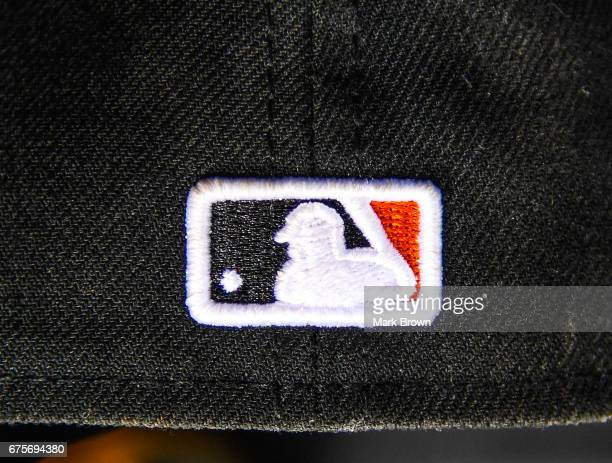 Major League Baseball logo on the back of a New Era hat during the game between the Miami Marlins and the Pittsburgh Pirates at Marlins Park on April...